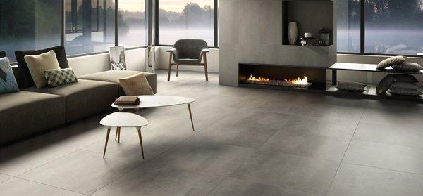 Căn phòng ấm cúng và giản dị hơn với bề mặt cement
